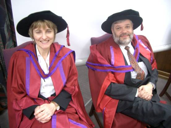 Photograph of Janet Peacock and Martin Bland in academic dress.